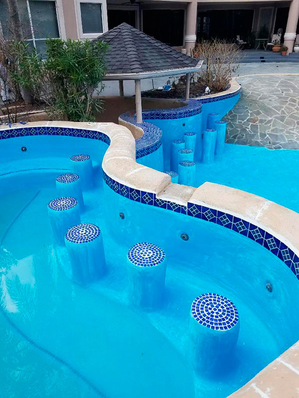 Commercial pool construction - pool with bar stools